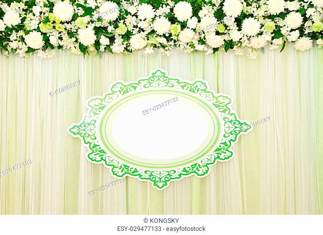 Beautiful white and green backdrop flowers arrangement over white fabric ready for wedding ceremony
