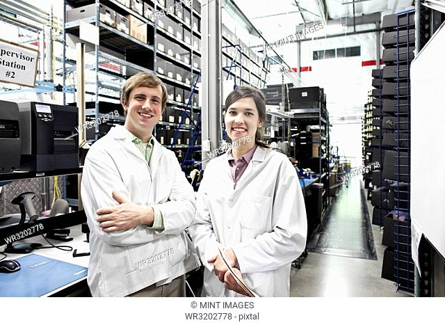 A portrait of a team of two male and female technicians working in a technology research and development site