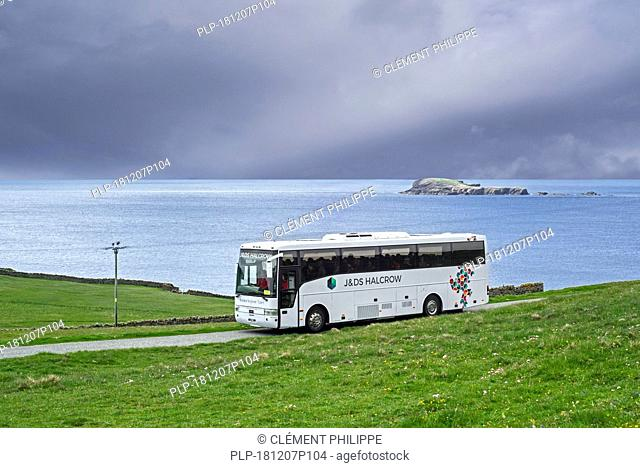 J&D S Halcrow bus driving tourists to Sumburgh Head at the southern tip of Mainland of Shetland, Scotland, UK