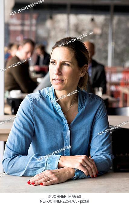 Woman in cafe looking away