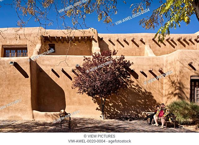 New Mexico Museum of Art, Santa Fe, United States. Architect: Isaac Hamilton Rapp, 1917. Detailed view of earth coloured walls in sunlight