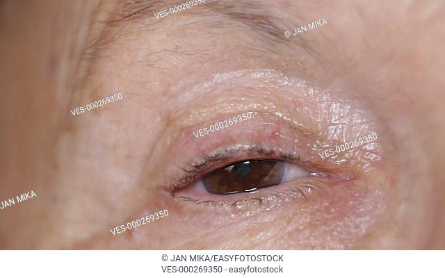 Macro of sleepy eye of senior female