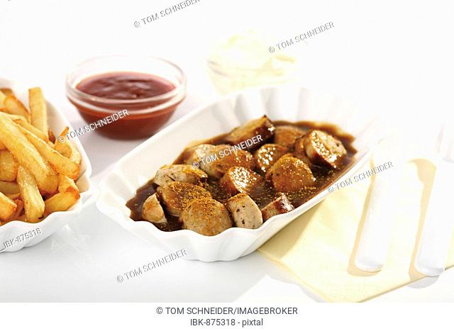 Curry sausage with chips, ketchup and mayonnaise