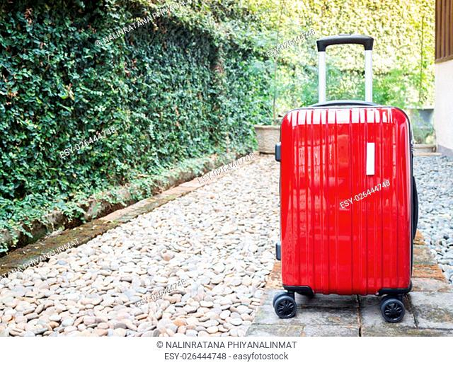 Red travel suitcase for outgoing, stock photo