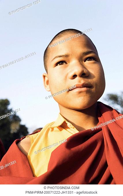 Close-up of a monk day dreaming, Mahabodhi Temple, Bodhgaya, Gaya, Bihar, India