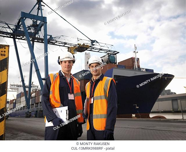 Port Workers In Front Of Ship