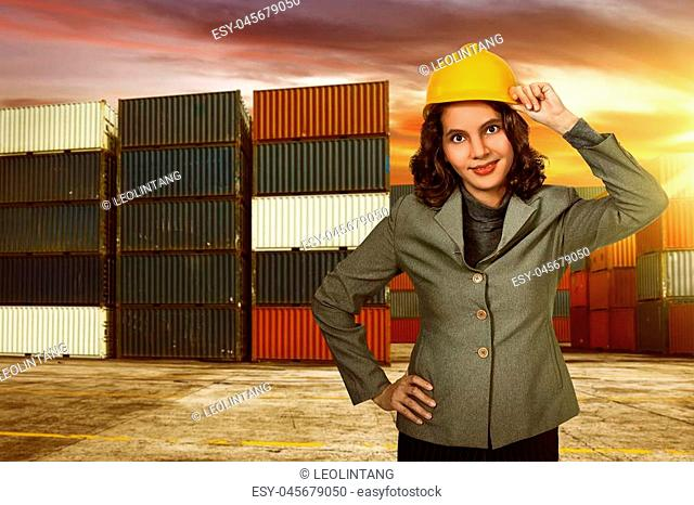 Woman wearing a yellow helmet was a photo in the harbor
