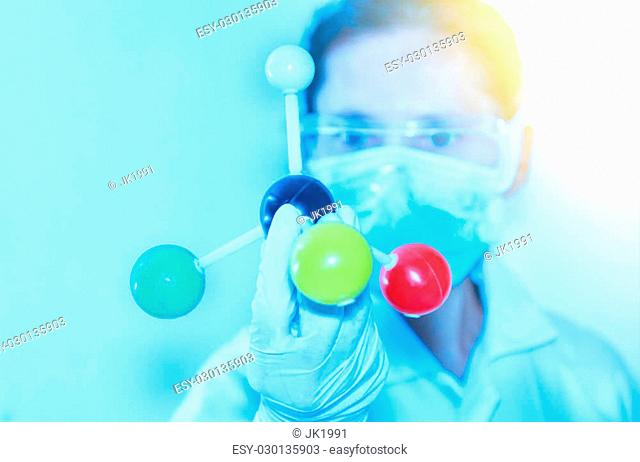 Scientist with molecule model and science concept