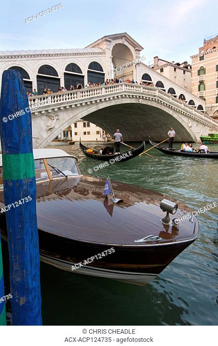 Water taxi, gondolas and the Rialto Bridge, Venice, Italy