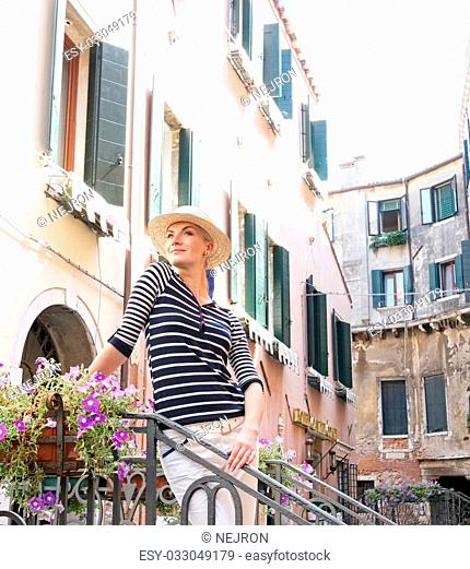 Woman in hat outdoors