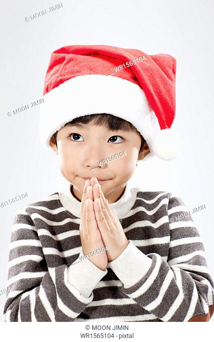 close up shot of a kid with Santa hat