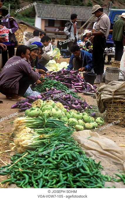 Vegetables for sale at Yi Minority People's Marketplace in Kunming, Yunnan Province, People's Republic of China