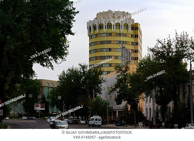 Tashkent, Uzbekistan - April 25, 2015: A view of round building in the city, constructed using soviet architecture