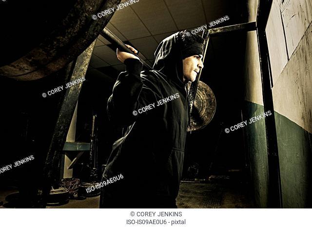 Weightlifter in dark gym