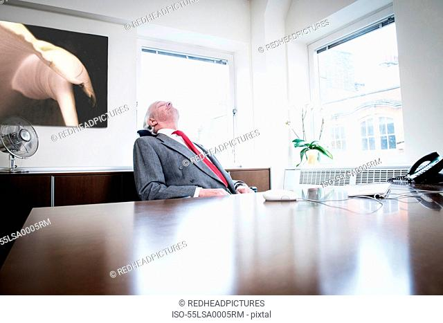 Businessman leaning back in chair