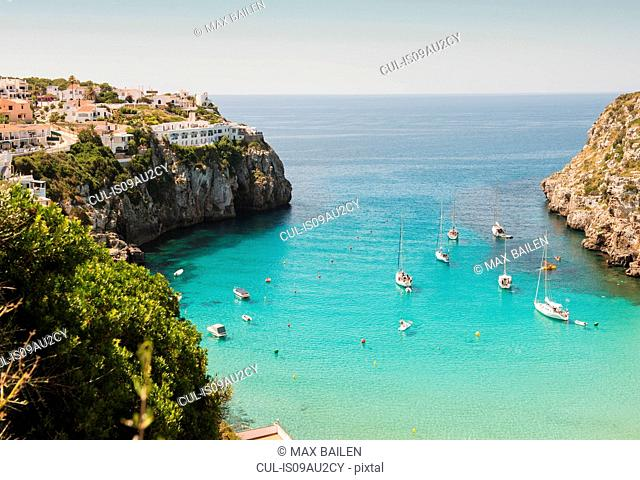 Elevated view of two boats and yachts anchored in bay, Menorca, Balearic islands, Spain