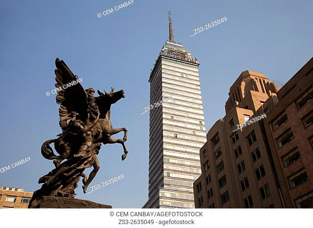 View to the Torre Latinoamericana, 44 stories tall skyscraper with a statue in the foreground, Mexico City, Mexico, Central America
