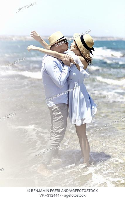couple at beach, love, summer, holidays, playful