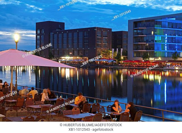 River harbour with outside restaurants, Duisburg, NRW, North Rhine-Wesphalia, Ruhr district, Germany
