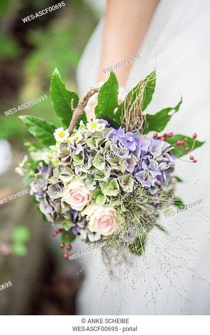 Close-up of bride holding bridal bouquet