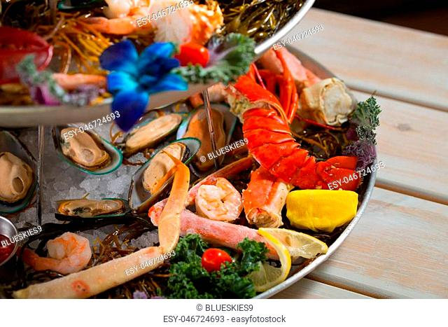 Close up shot of asssorted seafood on a platter with lobster
