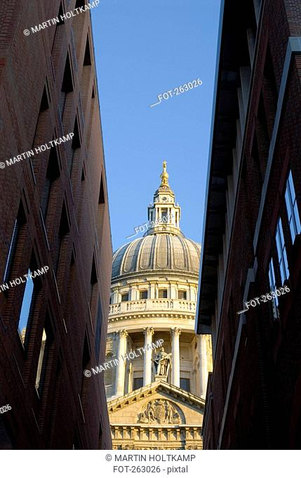View of St. Paul's Cathedral between buildings, London, England