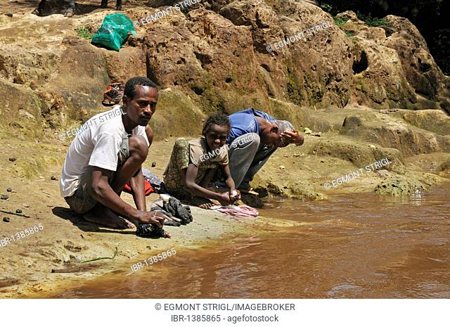 African laundry at a river in the Rift Valley, Oromia, Ethiopia, Africa