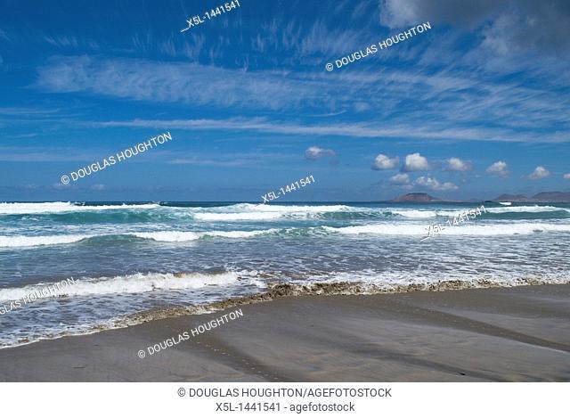 Playa de Famara FAMARA LANZAROTE Surf waves breaking on sandy beach