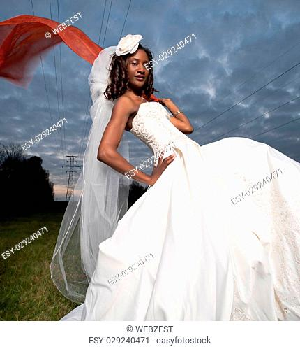 Beautiful image of a wedding dress with orange scarf