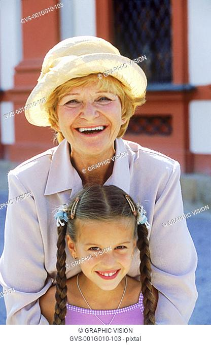 Elderly woman holding a young girl