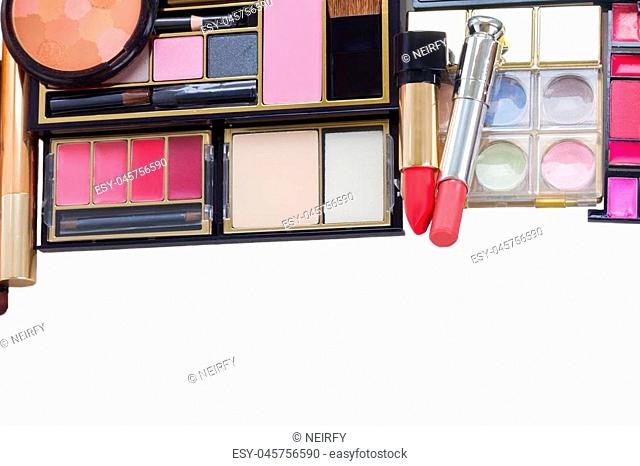make up products border isolated over white background, top view