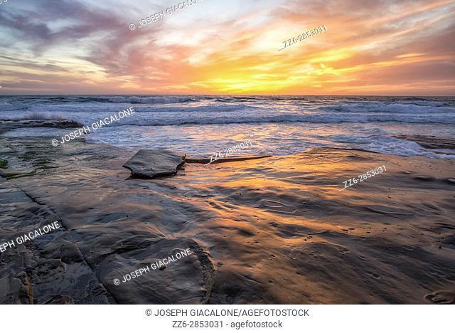 Coastal sunset with rocky coast, Hospital's Reef, La Jolla, California, USA