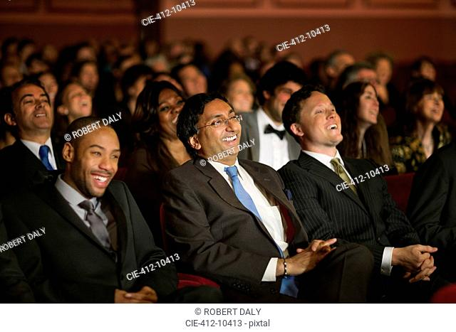 Laughing theater audience