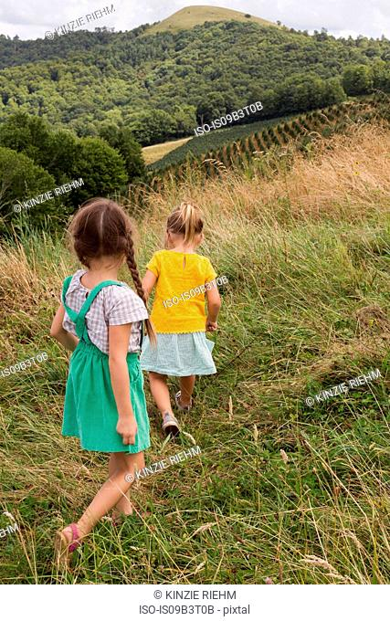 Two young girls exploring outdoors