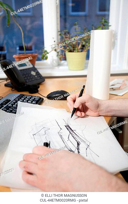 Architect sketching at desk