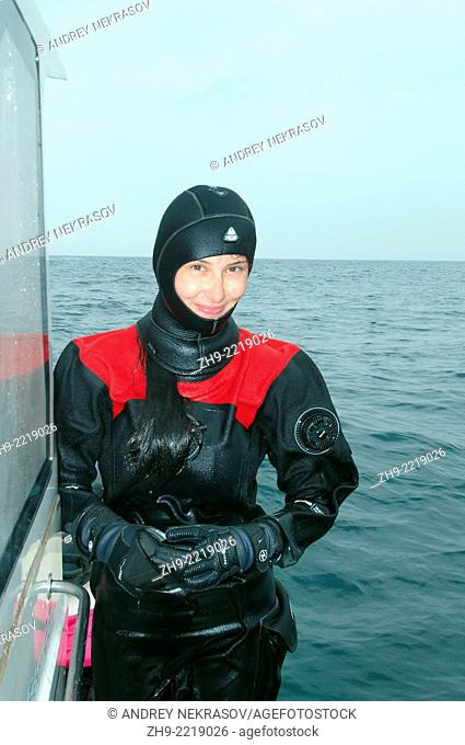 divewoman. Islands Verkhovskogo, Peter the Great Gulf, Sea of Japan, Far East, Vladivostok, Russia