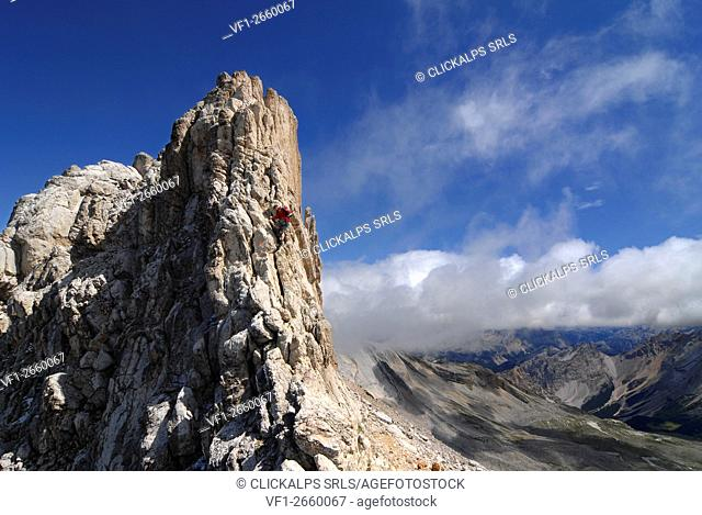 Alta Badia, Dolomites, South Tyrol, Italy. Climber on the via ferrata of the Cima Dieci / Zehnerspitze in the Dolomites of Fanes