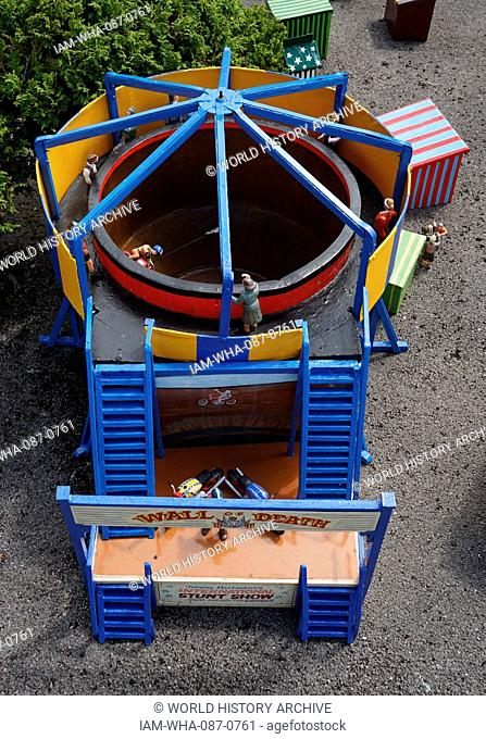 Wall of Death Cycle attraction at the travelling fairground visits the model village at Bekonscot in Beaconsfield, Buckinghamshire, England
