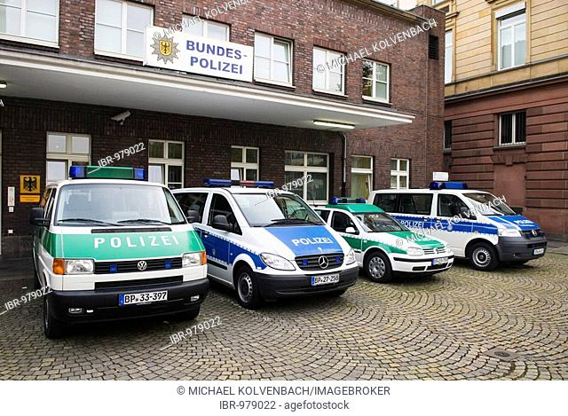 Former green and new blue police cars lined up in front of a German police station at Duesseldorf Central Statiion, Duesseldorf, North Rhine-Westphalia, Germany