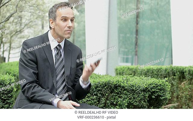 Business Man receives a call outside the office