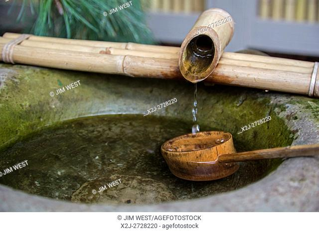Fort Wayne, Indiana - A Japanese tea garden exhibit at the Foellinger-Freimann Botanical Conservatory. The stone basin (Chozubachi) allows guests to purify...
