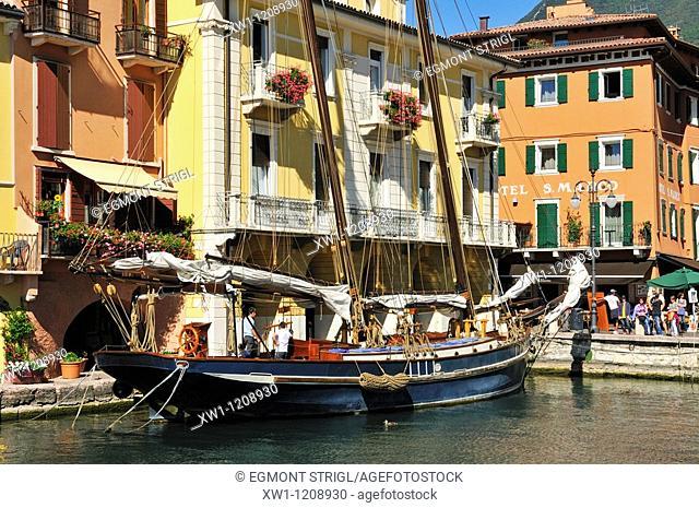 old sailboat in the harbor of Malcesine, Lake Garda, Veneto, Venetia, Italy, Europe