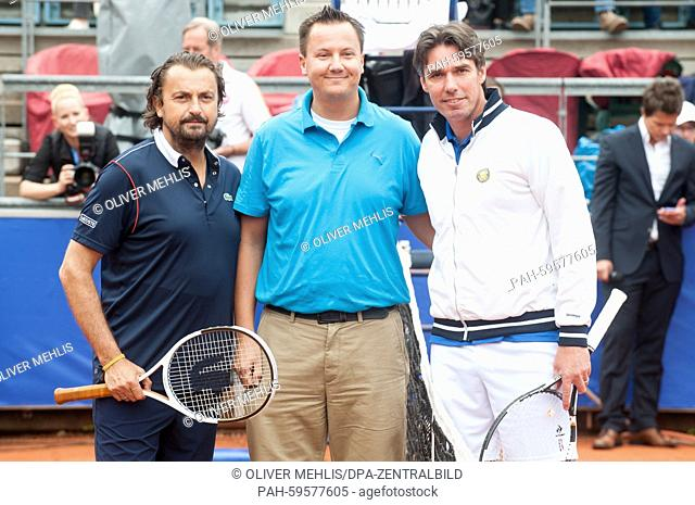 French former tennis player Henri Leconte (L) and his German opponent Michael Stich pose at the Grand Champions Tennis Tournament in Berlin,Germany