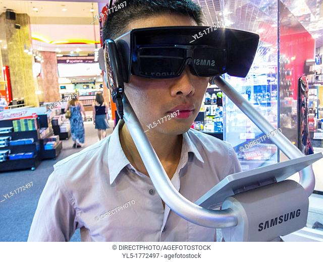 Paris, France, Chinese Man Using Three Dimensional Glasses 3D for High Definition T V  in VIrgin Store, Shopping on the Avenue Champs Elysees