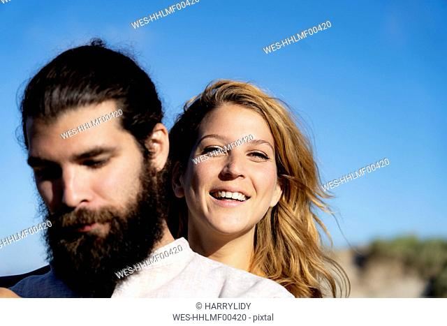 Portrait of a happy couple, spending time in nature