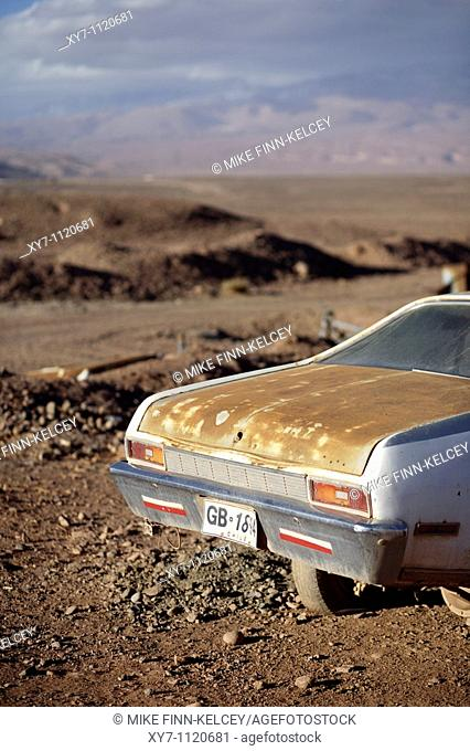 A rusty American car in the desert near San Pedro de Atacama in Chile