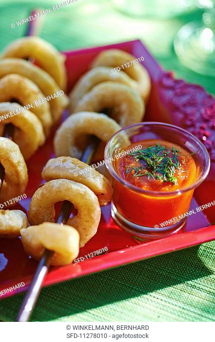 Squid rings with a spicy tomato and pepper dip