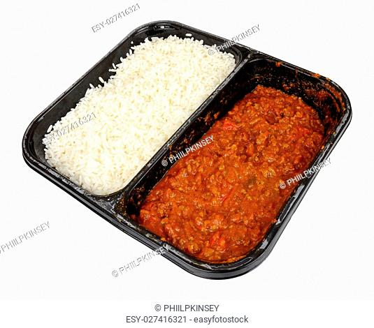 Chilli con carne convenience meal with boiled rice in a black plastic tray isolated on a white background