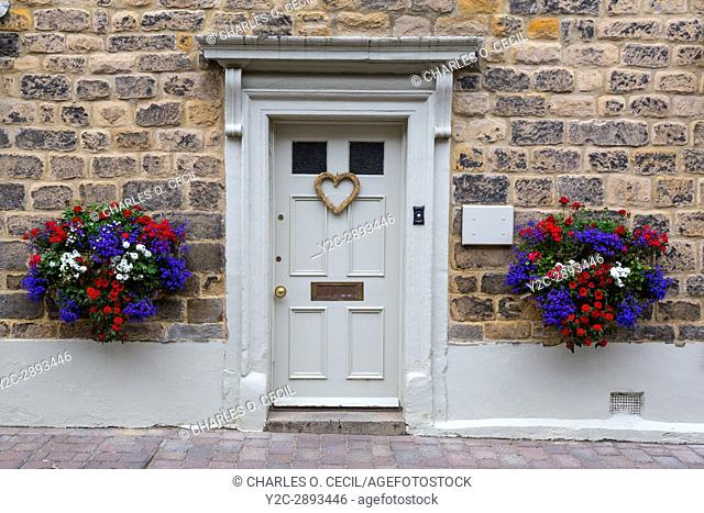 Corbridge, England, UK. Doorway with Flowers