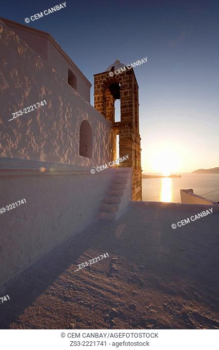 Bell tower of the white domed church of Panagia Thalassitra at sun, Milos, Cyclades Islands, Greek Islands, Greece, Europe